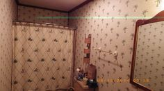 Denise's Bathroom re-wallpapered.