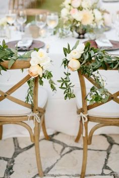 Floral garland bride and groom chairs   event styling by http://bashplease.com/   photography by http://erinheartscourt.com/