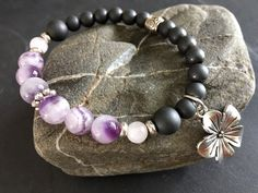 - Burren Wildflowers - This lavender and deep gray design is inspired by the Burren area of west County Clare, Ireland where wildflowers and other plants somehow grow and t... #trending #etsy #etsymntt