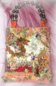 Handmade purse, spring themed crazy quilt with buttons,  beading, silk ribbon flowers, motifs and ornate embroidery  stitching.