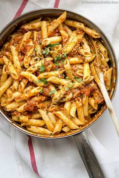 Penne Arrabiata- Simple, spicy and Vegan Italian sauce tossed with pasta, topped with parmigiano reggiano cheese