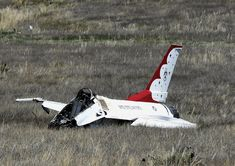 An Air Force F-16 with the Thunderbirds air demonstration squadron sits crashed in a field four miles south of Colorado Springs after performing a fly-over at the U.S. Air Force Academy graduation ceremony (June 2, 2016). The pilot, Major Alex Turner, was able to eject and was unhurt.