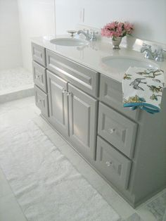paint your builder basic vanity gray and give it a marble countertop