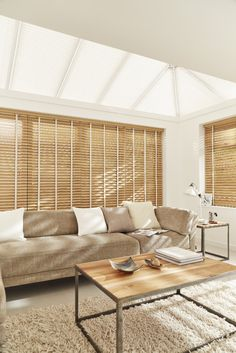 Create a warm feel to your conservatory with wooden blinds. Match your accessories with wood tones and natural shades to create a homely feel.