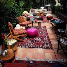 Moroccan touch in another European residence. Low tables, Moroccan poufs, Moroccan styled cushions and kilim rugs etc.
