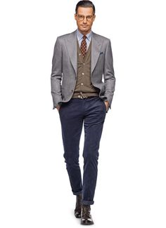 Using a wool-cashmere fabric woven by Vitale Barberis Canonico this grey jacket is tailored to our Washington Half fit. Style the jacket with blue corduroy pants, cardigan, and boots for a look that works that suits every setting. Suit Supply