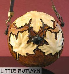 Gourd by James Booker Preston. This particular gourd caught my eye because of the smooth carving of the leaves. Was something used to smooth out the carving. That is an interesting technique.