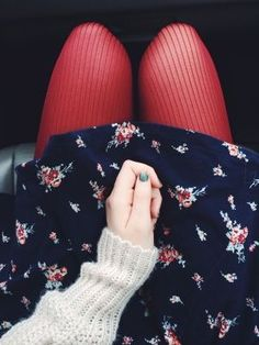 Bright tights, floral skirt, chunky sweater.