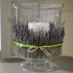 wow, what a great idea!  cheap, unscented candles, but wrap with lavender for that incredible smell!