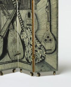 PIERO FORNASETTI, Strumenti Musicali/Libri double sided screen by Fornasetti Milano, Italy , 1954. Lithographic transfer print on lacquered wood, brass. Coming up for sale at Wright Design Auction, March 27th. / Wright