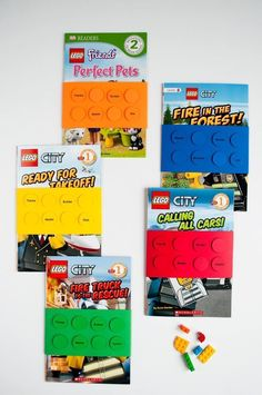 Make these quick and easy DIY LEGO birthday party favors for a LEGO birthday party: personalized paper book wraps that look like LEGO bricks.