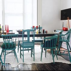Create a set of colorful dining chairs out of mix-and-match thrift-store finds by painting them all the same hue. | Photo: Rebecca Duke/IPC Images | thisoldhouse.com