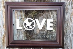 Vinyl Decal - Hunger Games inspired LOVE vinyl decal with Mockingjay