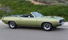 from  badasscarz26   1969 plymouth barracuda formula S fastback     1970 Plymouth Cuda   This numbers matching low mileage convertible is Green  and has the Super Commando engine