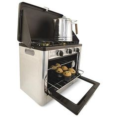This baby starts my list of things I want for camping/survival. Camp Chef® Portable Outdoor Stove - top / Oven