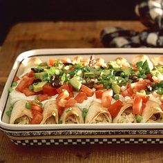 These easy, cheesy chicken enchiladas come together in a snap and are faster and way more delicious than fast food.