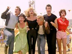 "The movie ""Grease"", directed by Randal Kleiser. Seen here from left, John Travolta (back to camera) as Danny Zuko and Olivia Newton-John a. Famous Movies, Iconic Movies, Old Movies, Classic Movies, Great Movies, Grease Outfits, Grease Costumes, Greece Movie, Rizzo Grease"