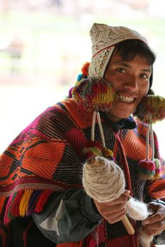 Peru...Both men and women weave beautiful colorful hats, ponchos, and scarves.