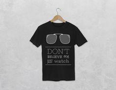 T-shirt noir imprimé avec le visuel « Don't believe me just watch » de la collection Lyrics de la marque hoodoo. Mark Ronson, T Shirt Noir, Believe, Lyrics, T Shirts For Women, Mens Tops, Shopping, Collection, Fashion
