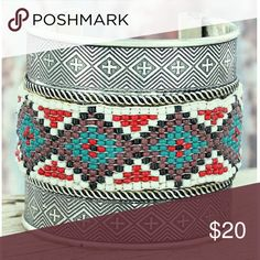 """Beautiful! Santa Fe Sead Bead Silver Cuff Stylish cuff will add a Southwestern touch to your look!  Textured Burnished Silvertone with Black Accents Ivory, Red, Turquoise, Brown, and Black Seed Beads 2.5"""" Wide Band Cross Design 2.25""""-2.5"""" Diameter 7.25"""" Inside Circumference Including 1.25"""" Gap No Closure Buckle Jewelry Bracelets"""