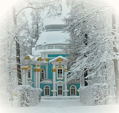 A turquoise house in snow-covered woods ~ my heart's desire