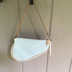 Authentic small Dior light Blue Saddle Bag Authentic small Dior light Blue Saddle Bag,tags are still attached. Sale tag $110, will trace for a faux Chanel bracelet. Dior Bags Shoulder Bags