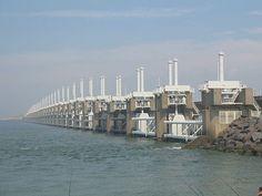The Oosterscheldekering (in English: Eastern Scheldt storm surge barrier), between the islands Schouwen-Duiveland and Noord-Beveland, is the largest of the 13 ambitious Delta Works