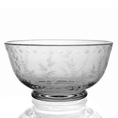 A charming hand cut leaf design on this classical bowl. A practical and perfect piece of handmade glassware. A close up picture of the new Titania design is available. This is a delightful handcut design taken from an original Regency design. A wonderful example of traditional craftsmanship on these practical and pretty pieces. Also see Titiana Vases. Style: Rich Cut
