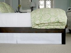 Dust Ruffle with a tension rod.  Then the ruffle doesn't move under the mattress.