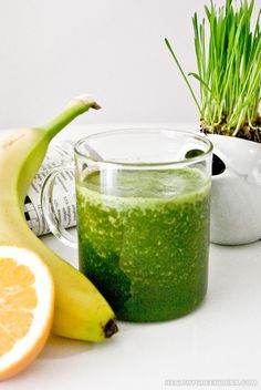 Coffee alternative wheatgrass green drink smoothie recipe that also contains orange juice and banana.