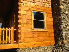 6 x 12 Chink Joint Logs - Hand Hewed by home owner to his liking. We cut the Dovetails. A very cool, rustic home. I like his choice of window trim and rails.