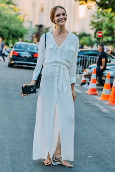 Stunning Sasha Pivovarova in a long white dress and flat Sandals. Tres chic! (Photo credit: Style)