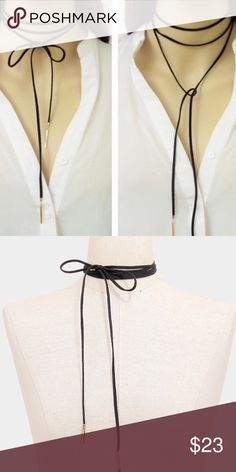"Suede Wrap Chocker Necklace Trendy, black suede tie necklace with gold accents. Can be worn in multiple different ways!  Length: 50""   Decor size: 0.2"" Jewelry Necklaces"