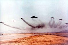This has to be one of the coolest and the LOUDEST military aviation photos in history. No less than three Tomcats and three Phantoms are headed by an SR-71 Blackbird as they pour on the coals during a high-speed, low-level flyby over NAWS China Lake. The circumstances of how this shot came to be remain a mystery, but I would like to thank it happened because it simply had to.