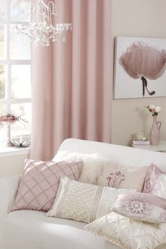 Pink and white living room, so lovely. Pink drapes, pink and white pillows, white sofa. A perfectly decorated room.