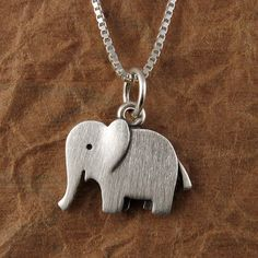 cute little elephant, not sure about the chain