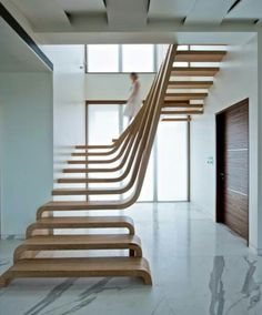 Amazing stairs, classic marble, white walls, and wood grain.  Well played home owner... well played.