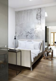 Modern take on the sleigh bed, and cool neutral tones.