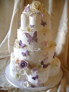 Butterflies & Pearls wedding cake by nice icing, via Flickr if the theme is purple this will be my cake :)