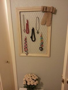 Made from door frame molding...painted distressed add some chicken wire and cute bow...makes super cute way to hold necklaces. ..