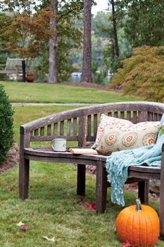 A pillow and throw make this bench the perfect place to sip a cup of coffee on a crisp fall day!