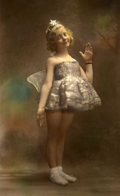 Found image. This lovely hand tinted photograph shows a girl dressed as a fairy for a ballet performance. It is a very skilled piece of work by the photographer Rousham Roberts in Llandrindod Wells.