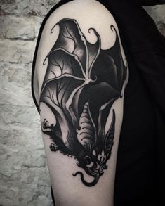 Hyper- realism. This hyper-realism bat tattoo is associated with Lucifer itself. Do you agree?