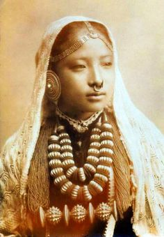"Nepali girl, variously identified as 1890 and 1910 - holy heck, that must be the biggest, fanciest tiluri I've ever seen. (The gold medallions on the lower necklace with the beads.) It's a sign of marriage. I guess she was REALLY married. (Also, this gets labeled ""Nepalese woman,"" but look at her face ... I'm guessing she's about 13-14 and this is a bridal portrait)"