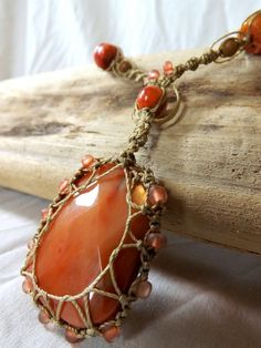 Beautiful macrame adjustable necklace with fauceted stone pendant and coral beads on a thick bronze chain. Chain has decorative peace