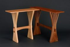 A trestle style console table held together with traditional tenon and wedge joinery. The two ends are elegant tree forms made from a single piece of wood.