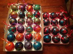 I saw these ornaments on Pinterest last Fall and thought they would make wonderful gifts for my family! They're made with melted crayons! (I used glitter crayons for these). Just break the crayons into small pieces, put your chosen colors in a clear glass ornament, heat with a hair dryer, and swirl it around until it looks pretty :)