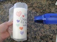 Draw on wax paper with permanent markers, wrap around candle and heat until image is transferred diy....fun with kids!