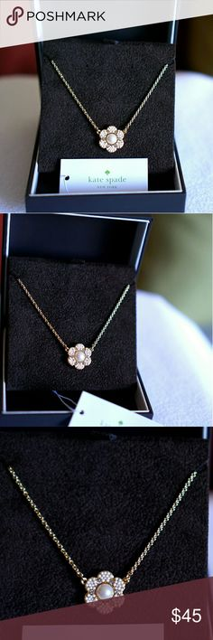 Kate Spade Park Floral Mini Pendant Item is new with tags.   Product description: Bubbly faux pearls and twinkling crystals arranged in a floral silhouette define vintage-inspired pendant necklace. Sparkling floral pendant decorated with faux pearls & glass crystals. The pendant suspends from a 18-inch gold tone cable chain. Chain necklace. Adjustable lobster clasp closure. Imported. (Box not included) kate spade Jewelry Necklaces
