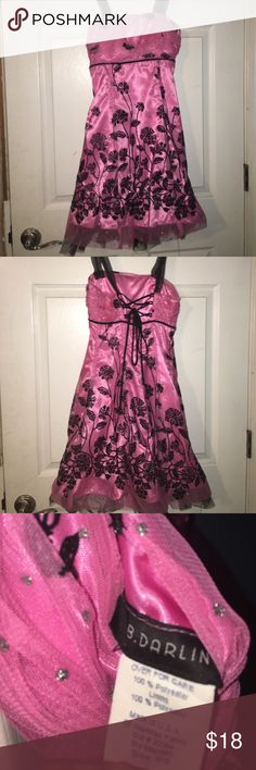 Floral pink dress Tag says 5/6 but looks more about 10/12 because it was used for 6th grade promotion - minor alteration on strap but can be fixed but other than that great condition B Darlin Dresses